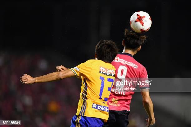 Kenyu Sugimoto of Cerezo Osaka and Yasuhiro Hiraoka of Vegalta Sendai compete for the ball during the JLeague J1 match between Cerezo Osaka and...