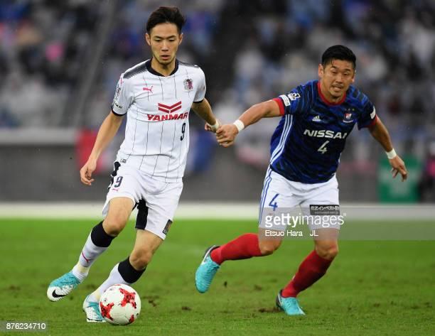 Kenyu Sugimoto of Cerezo Osaka and Yuzo Kurihara of Yokohama FMarinos compete for the ball during the JLeague J1 match between Yokohama FMarinos and...