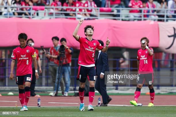 Kenyu Sugimoto of Cerezo Osaka celebrates scoring his first goal with teammates during the JLeague J1 match between Cerezo Osaka and Gamba Osaka at...