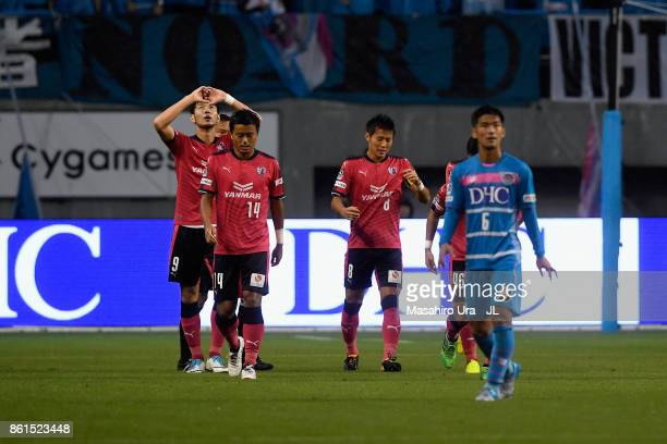 Kenyu Sugimoto of Cerezo Osaka celebrates scoring his side's first goal with his team mates during the JLeague J1 match between Sagan Tosu and Cerezo...