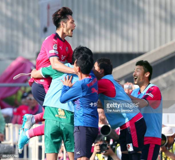 Kenyu Sugimoto of Cerezo Osaka celebrates scoring his side's fourth goal with his team mates during the JLeague J1 match between Cerezo Osaka and...