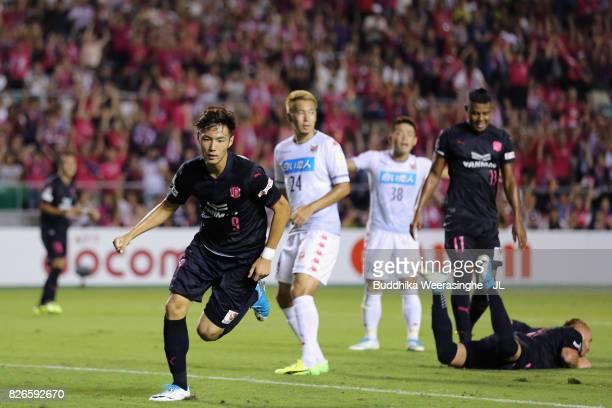 Kenyu Sugimoto of Cerezo Osaka celebrates scoring his side's third goal during the JLeague J1 match between Cerezo Osaka and Consadole Sapporo at...