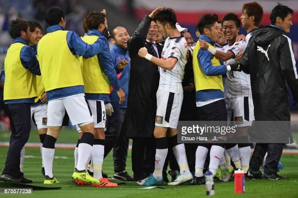 Kenyu Sugimoto of Cerezo Osaka celebrates scoring his side's third goal with his team mates during the JLeague J1 match between Yokohama FMarinos and...