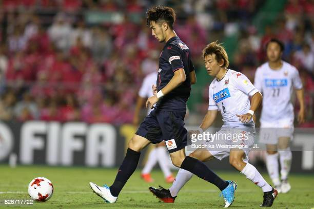 Kenyu Sugimoto of Cerezo Osaka controls the ball under pressure of Shingo Hyodo of Consadole Sapporo during the JLeague J1 match between Cerezo Osaka...