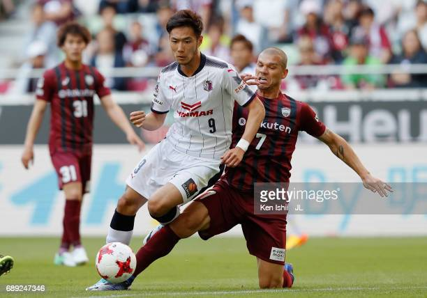 Kenyu Sugimoto of Cerezo Osaka is tackled by Nilton of Vissel Kobe during the JLeague J1 match between Vissel Kobe and Cerezo Osaka at Noevir Stadium...