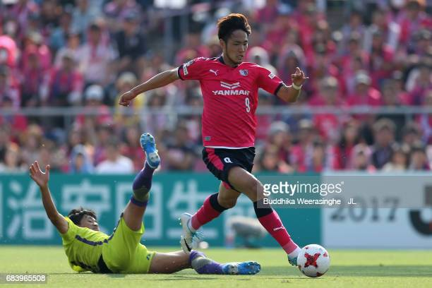 Kenyu Sugimoto of Cerezo Osaka runs past Kazuhiko Chiba of Sanfrecce Hiroshima during the JLeague J1 match between Cerezo Osaka and Sanfrecce...
