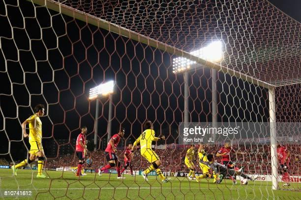 Kenyu Sugimoto of Cerezo Osaka scores his side's first goal past Kosuke Nakamura of Kashiwa Reysol during the JLeague J1 match between Cerezo Osaka...