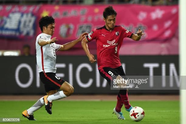 Kenyu Sugimoto of Cerezo Osaka takes on Wataru Endo of Urawa Red Diamonds during the JLeague J1 match between Cerezo Osaka and Urawa Red Diamonds at...