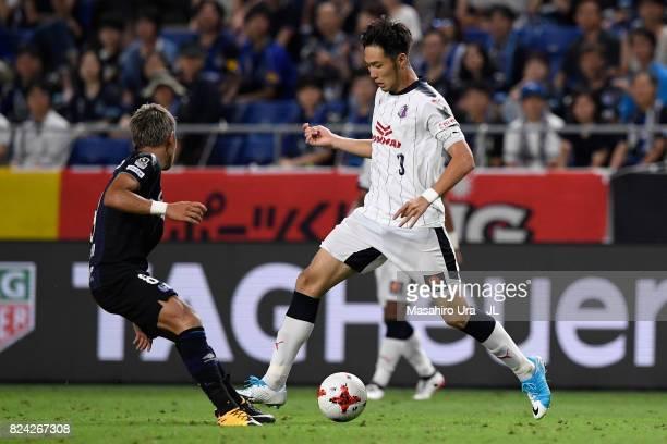 Kenyu Sugimoto of Cerezo Osaka takes on Yosuke Ideguchi of Gamba Osaka during the JLeague J1 match between Gamba Osaka and Cerezo Osaka at Suita City...