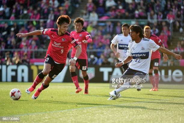 Kenyu Sugimoto of Cerezo Osaka takes on Yuji Nakazawa of Yokohama FMarinos during the JLeague J1 match between Cerezo Osaka and Yokohama FMarinos at...