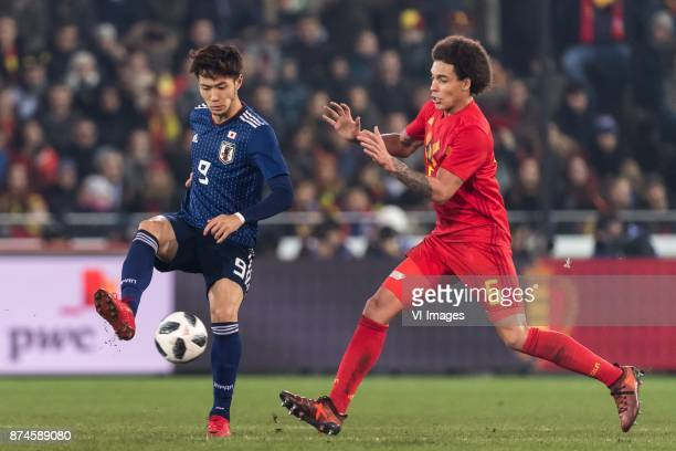 Kenyu Sugimoto of Japan Axel Witsel of Belgium during the friendly match between Belgium and Japan on November 14 2017 at the Jan Breydel stadium in...