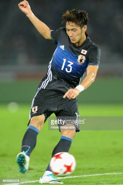 Kenyu Sugimoto of Japan shoots at goal during the international friendly match between Japan and Haiti at Nissan Stadium on October 10 2017 in...