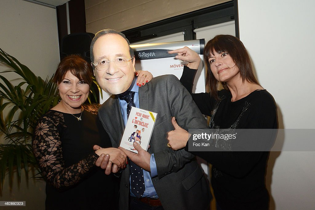 Kenza Braiga, a guest wearing a mask of Francois Hollande and Marion Dumas attend 'Petit Traite De L'Infidelite' (Little Treatise about Infidelity) Kenza Braiga Book Launch Cocktail hosted by Gleeden.com at the Movenpick Paris Neuilly on January 15, 2014 in Paris, France.