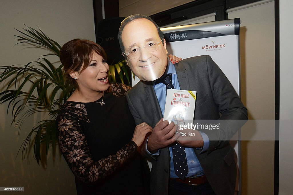 Kenza Braiga, and a guest wearing a mask of Francois Hollande attend 'Petit Traite De L'Infidelite' (Little Treatise About Infidelity) Kenza Braiga Book Launch Cocktail hosted by Gleeden.com at the Movenpick Paris Neuilly on January 15, 2014 in Paris, France.