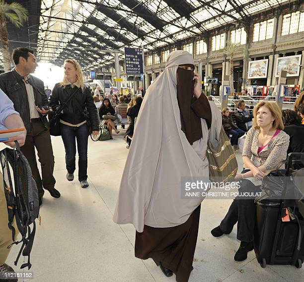 Kenza Drider a niqab veiled young woman from the southern city of Avignon who has become the media symbol of France's tiny community of niqab wearers...