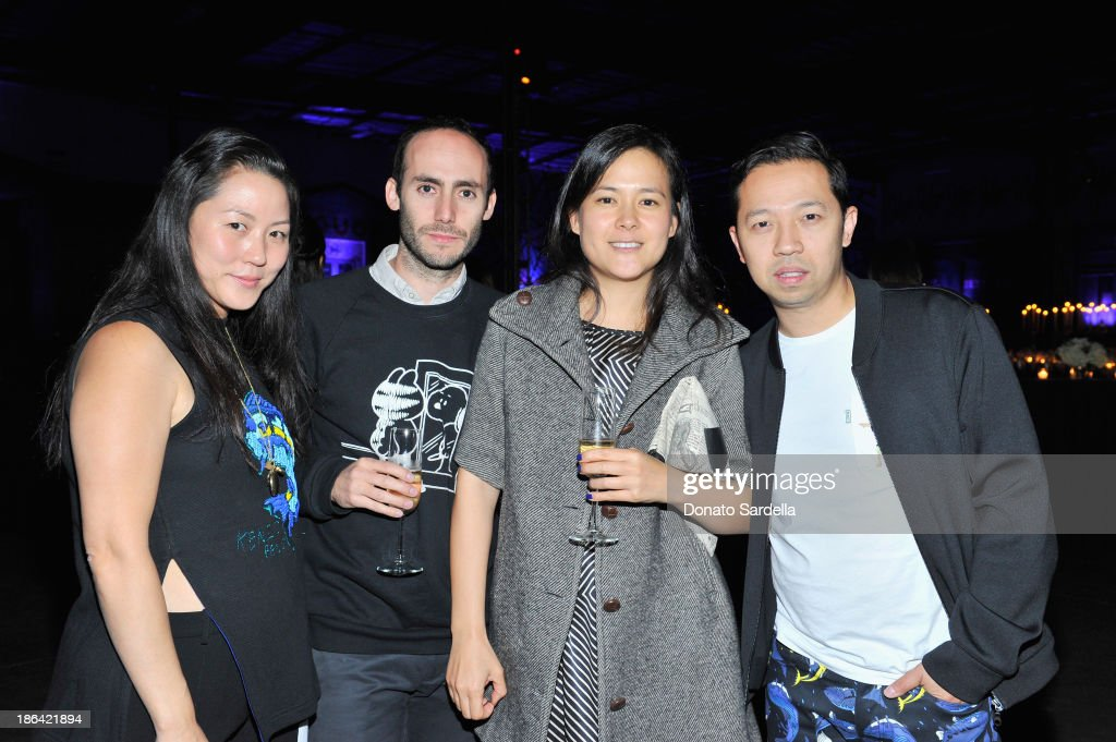 Kenzo designer <a gi-track='captionPersonalityLinkClicked' href=/galleries/search?phrase=Carol+Lim&family=editorial&specificpeople=4081625 ng-click='$event.stopPropagation()'>Carol Lim</a>, guest, Wendy Wao and Kenzo designer Humberto Leon attend the Kenzo Kalifornia launch dinner and party at The Berrics on October 30, 2013 in Los Angeles, California.