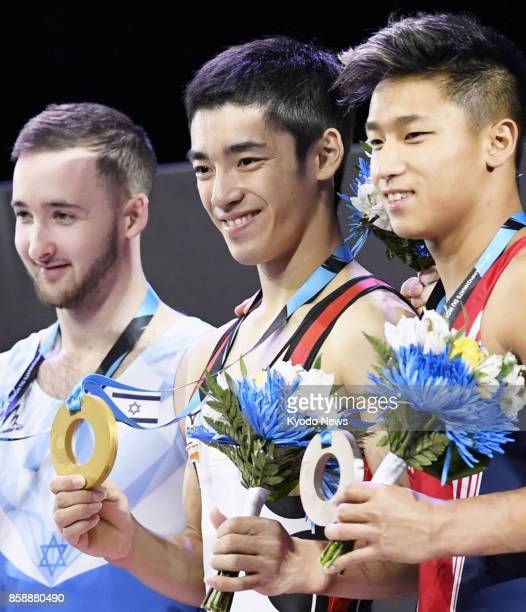 Kenzo Shirai of Japan poses for photos after winning the men's floor exercise final at the world gymnastics championships in Montreal Canada on Oct 7...