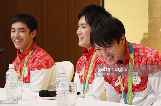 Kenzo Shirai Ryohei Kato and Kohei Uchimura laugh during a press conference in Narita east of Tokyo after returning from Rio de Janeiro on Aug 20...