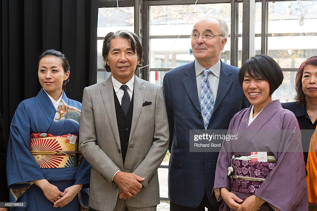<a gi-track='captionPersonalityLinkClicked' href=/galleries/search?phrase=Kenzo+Takada&family=editorial&specificpeople=2266256 ng-click='$event.stopPropagation()'>Kenzo Takada</a> and Deputy for Employment, Economic Development and International Attractiveness Christian Sautter attend the 'Solidarite Fukushima' exhibition in tribute to the victims of Fukushima on December 5, 2013 in Paris, France.