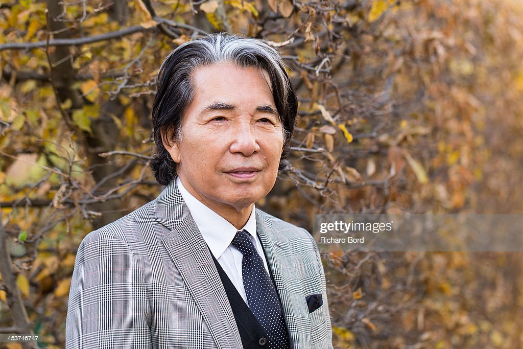 <a gi-track='captionPersonalityLinkClicked' href=/galleries/search?phrase=Kenzo+Takada&family=editorial&specificpeople=2266256 ng-click='$event.stopPropagation()'>Kenzo Takada</a> poses during the 'Solidarite Fukushima' exhibition in tribute to the victims of Fukushima on December 5, 2013 in Paris, France.