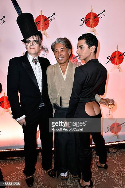 Kenzo Takada standing between Ali Mahdavi and Companion Djanis Bouziani attend the Kenzo Takada's 50 Years of Life in Paris Celebration at Restaurant...