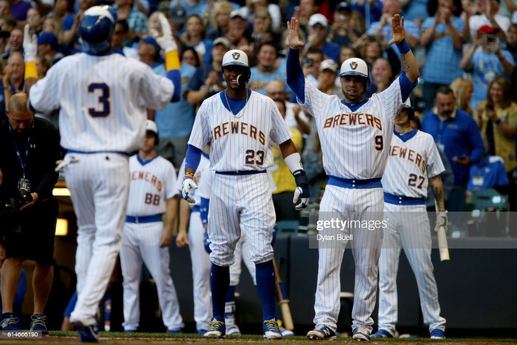 Keon Broxton #23 and Manny Pina #9 of the Milwaukee Brewers celebrate as Orlando Arcia #3 rounds the bases after hitting a home run in the second inning against the Philadelphia Phillies at Miller Park on July 14, 2017 in Milwaukee, Wisconsin.