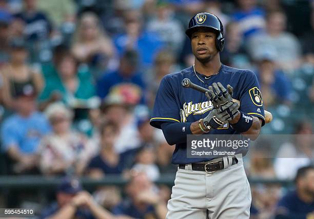 Keon Broxton of the Milwaukee Brewers adjust his batting gloves before and atbat in a game against the Seattle Mariners at Safeco Field on August 19...