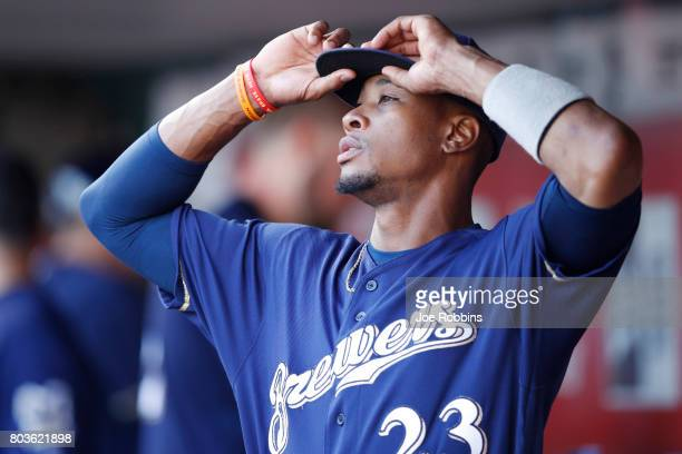 Keon Broxton of the Milwaukee Brewers adjusts his cap while in the dugout prior to a game against the Cincinnati Reds at Great American Ball Park on...