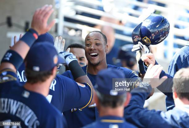 Keon Broxton of the Milwaukee Brewers and teammates in the dugout celebrate scoring a run during the first inning against the Kansas City Royals at...