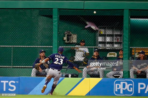 Keon Broxton of the Milwaukee Brewers can't field the ball on a double in the tenth inning against the Pittsburgh Pirates at PNC Park on July 19 2017...