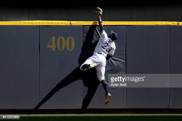 Keon Broxton of the Milwaukee Brewers catches a fly ball to end the game against the St Louis Cardinals at Miller Park on August 30 2017 in Milwaukee...