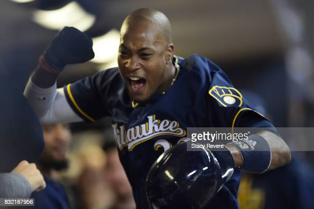 Keon Broxton of the Milwaukee Brewers celebrates a home run against the Pittsburgh Pirates during the seventh inning of a game at Miller Park on...