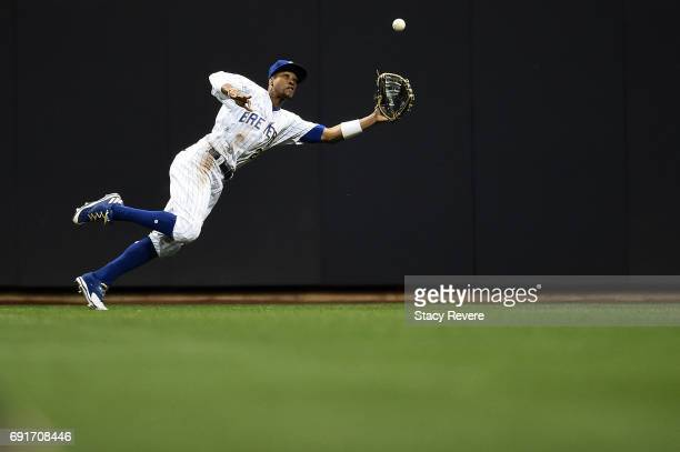 Keon Broxton of the Milwaukee Brewers dives for fly ball during the tenth inning of a game against the Los Angeles Dodgers at Miller Park on June 2...
