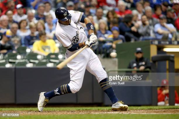 Keon Broxton of the Milwaukee Brewers hits a single in the fifth inning against the St Louis Cardinals at Miller Park on April 22 2017 in Milwaukee...