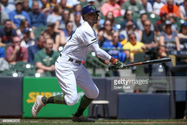 Keon Broxton of the Milwaukee Brewers hits a triple in the first inning against the Arizona Diamondbacks at Miller Park on May 28 2017 in Milwaukee...