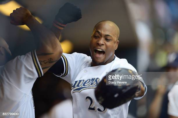 Keon Broxton of the Milwaukee Brewers is congratulated by teammates following a solo home run during the third inning of a game against the...