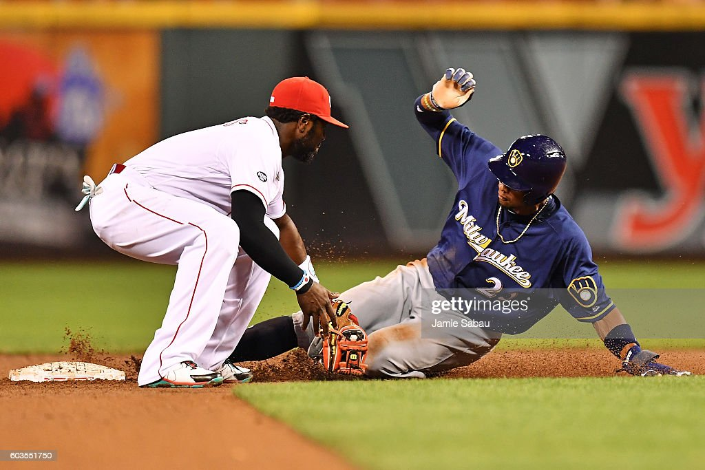 Keon Broxton #23 of the Milwaukee Brewers is tagged out by Brandon Phillips #4 of the Cincinnati Reds while trying to steal second base in the fourth inning at Great American Ball Park on September 12, 2016 in Cincinnati, Ohio. Cincinnati defeated Milwaukee 3-0.