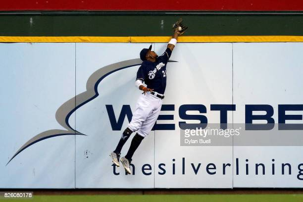 Keon Broxton of the Milwaukee Brewers leaps to catch a fly ball in the second inning against the St Louis Cardinals at Miller Park on August 3 2017...