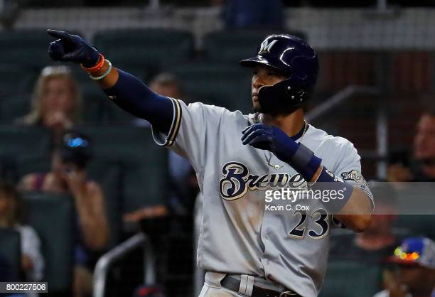 Keon Broxton of the Milwaukee Brewers reacts after scoring on a twoRBI double hit by Orlando Arcia in the eight inning against the Atlanta Braves at...