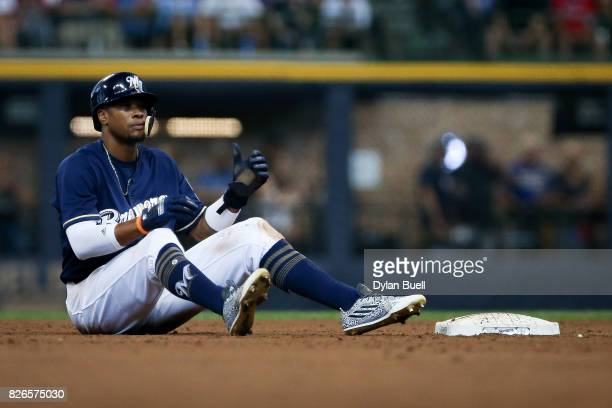 Keon Broxton of the Milwaukee Brewers sits on the field after the fifth inning against the St Louis Cardinals at Miller Park on August 3 2017 in...