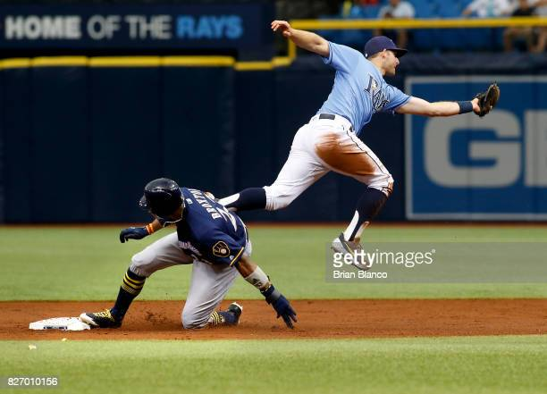 Keon Broxton of the Milwaukee Brewers steals second base ahead of second baseman Brad Miller of the Tampa Bay Rays during the third inning of a game...