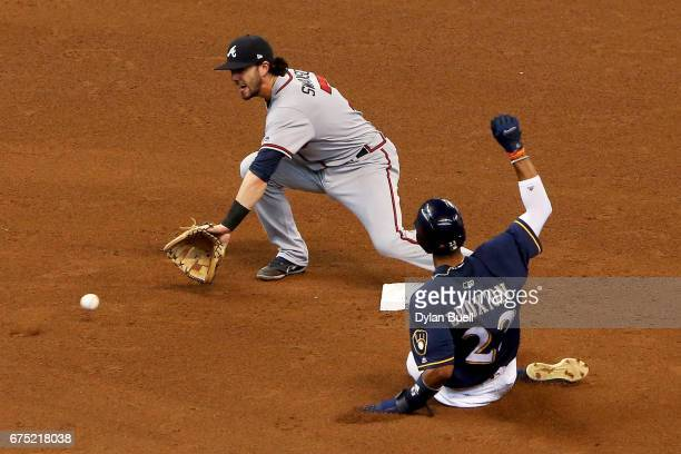 Keon Broxton of the Milwaukee Brewers steals second base past Dansby Swanson of the Atlanta Braves in the fifth inning at Miller Park on April 30...