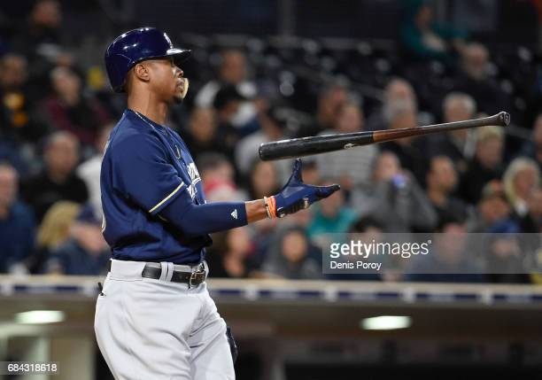 Keon Broxton of the Milwaukee Brewers tosses hit bat after striking out during the fifth inning of a baseball game against the San Diego Padres at...