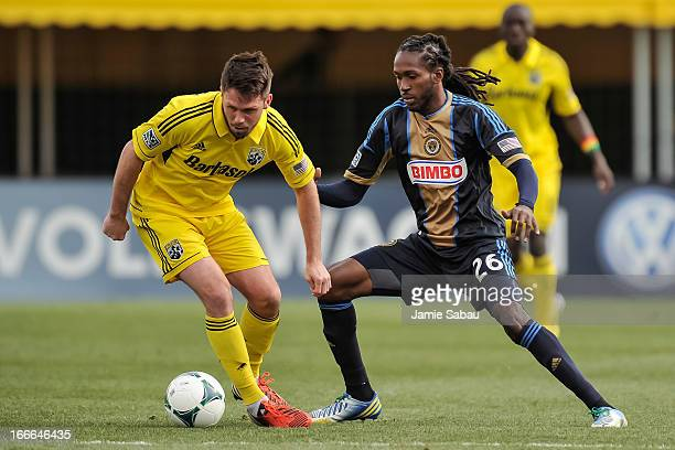Keon Daniel of the Philadelphia Union defends against Danny O'Rourke of the Columbus Crew on April 6 2013 at Crew Stadium in Columbus Ohio