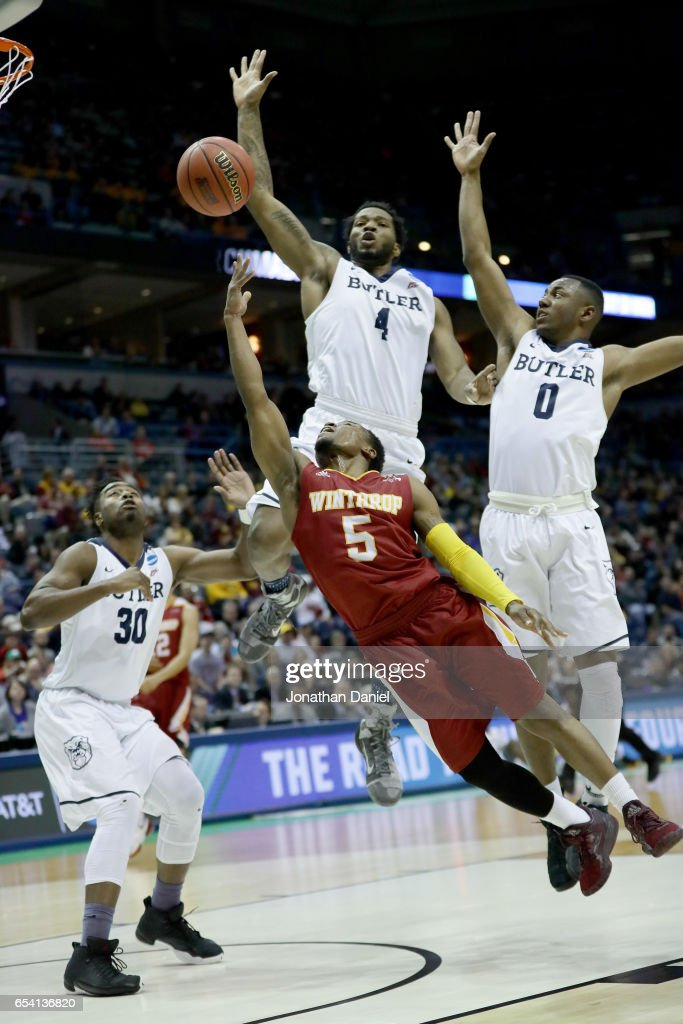 Keon Johnson #5 of the Winthrop Eagles attempts a shot past Kelan Martin #30, Tyler Wideman #4, and Avery Woodson #0 of the Butler Bulldogs in the first half during the first round of the 2017 NCAA Men's Basketball Tournament at BMO Harris Bradley Center on March 16, 2017 in Milwaukee, Wisconsin.
