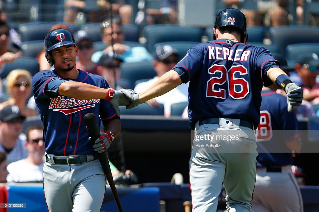 Kepler #26 of the Minnesota Twins is congratulated by Eduardo Escobar #5 after he hit a home run in the sixth inning against the New York Yankees during a game at Yankee Stadium on June 26, 2016 in the Bronx borough of New York City.