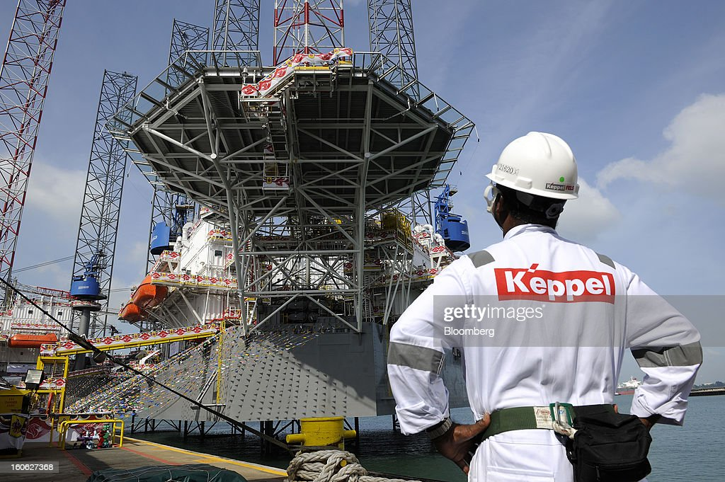 A Keppel Corp. employee looks at the Transocean Andaman jackup rig, built for Transocean Ltd., during a naming ceremony at the Keppel FELS shipyard in Singapore, on Saturday, Feb. 2, 2013. Keppel Corp.'s FELS unit received a combined $1.5 million bonus for completing the construction of two drilling rigs ahead of time, the company said in a statement. Photographer: Munshi Ahmed/Bloomberg via Getty Images