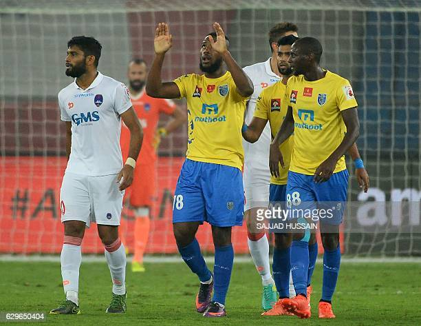 Kerala Blasters FC forward Duckens Nazon is watched by teammate Azarack Mahamat as he celebrates after scoring a goal against Delhi Dynamos FC during...