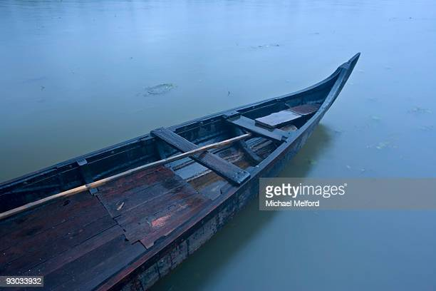 A traditional wooden boat in Kerala.