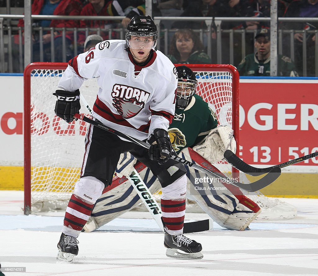 <a gi-track='captionPersonalityLinkClicked' href=/galleries/search?phrase=Kerby+Rychel&family=editorial&specificpeople=7375373 ng-click='$event.stopPropagation()'>Kerby Rychel</a> #16 of the Guelph Storm waits for a shot to tip in front of Justin Tugwell #1 of the London Knights in Game Four of the OHL Western Conference Semi Final at Budweiser Gardens on April 10, 2014 in London, Ontario, Canada. The Storm defeated the Knights 6-3 to take a 3-1 series lead.